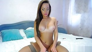 KittyCutie rubs her pussy and sucks dildo
