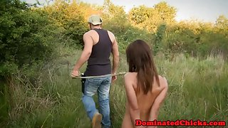 Tiedup slave babe dominated outdoors