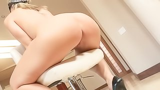 Blindfolded curvy woman Sara Jay naked but in high heel shoes shows off her amazing big bubble ass on a chair in the middle of the room. Her big booty is a amazing