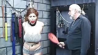 Lovely young redhead is bound in basement and whipped to bruising