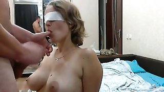 Busty slut that is blindfolded sucks penis of stranger