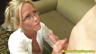 Classy cockloving cougar in glasses gives handjob